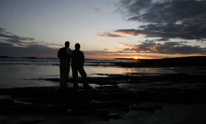 A couple walking on Warebeth Beach near Stromness on Orkney