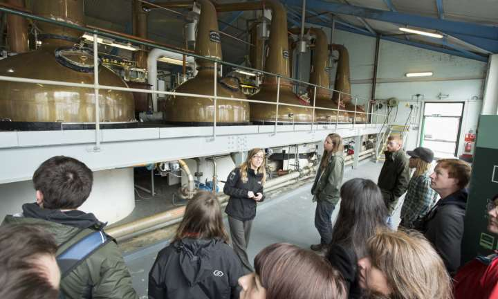 A distillery tour, seen here in the still room, at the Laphroaig Distillery on the Isle of Islay