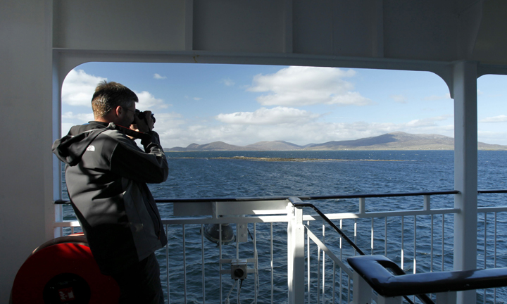 A passenger takes a photo from the ferry,