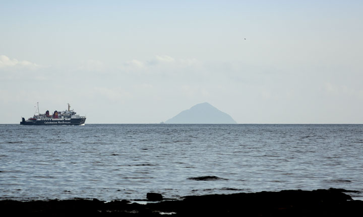 A ferry approaches the recognisable rock of Ailsa Craig.
