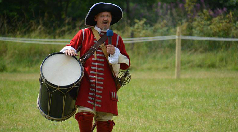 A redcoat carries a marching drum at the Soldiers of Killiecrankie