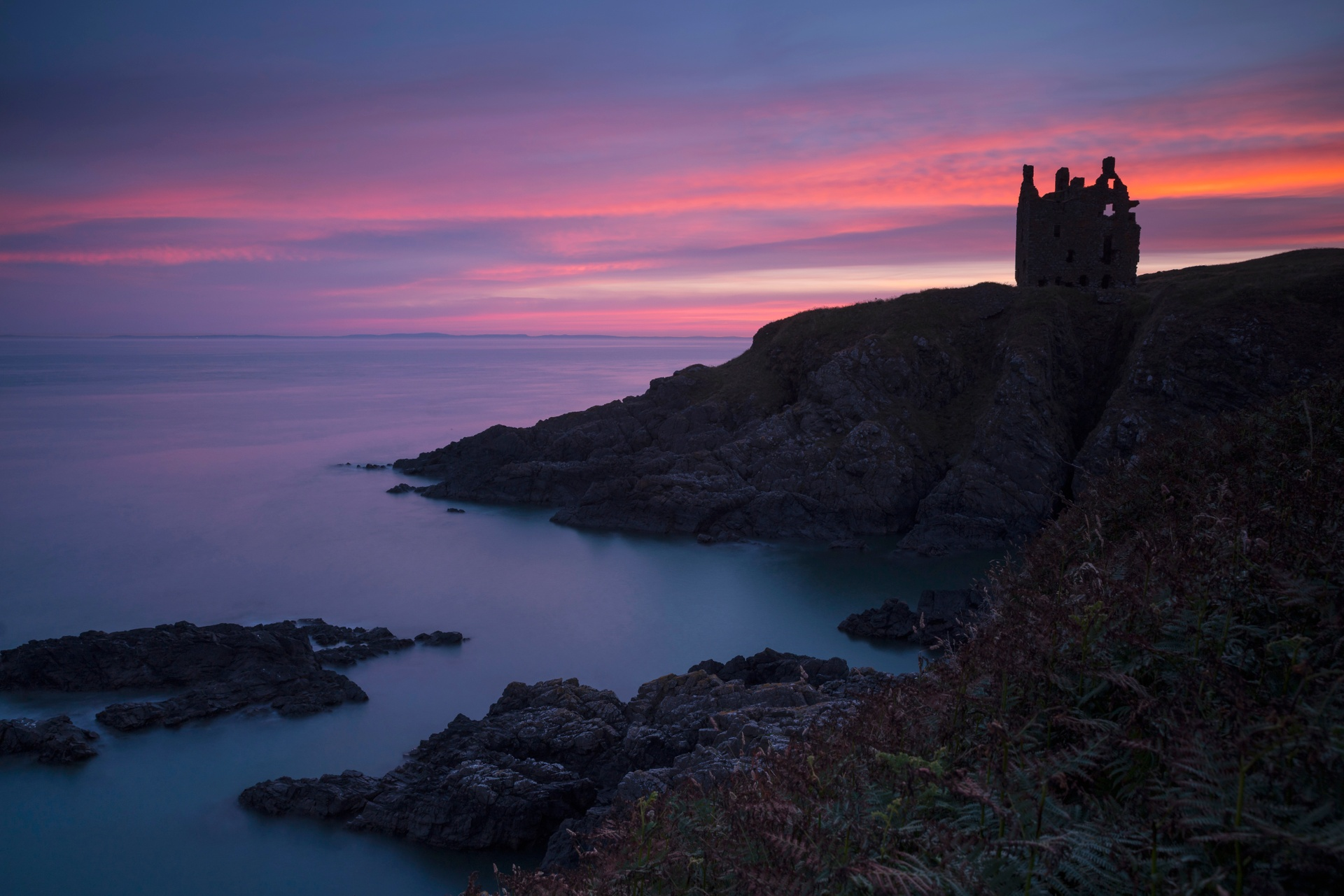 Dunskey Castle perched on a rocky outcrop jutting out into the Irish Sea was built in the mid-16th century for the Adairs of Kinhilt