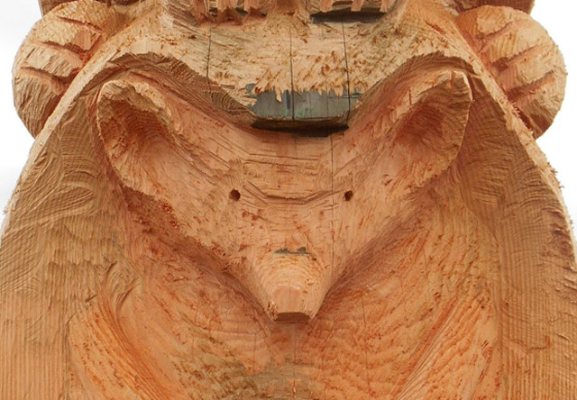A close-up of a wood carving of an animal