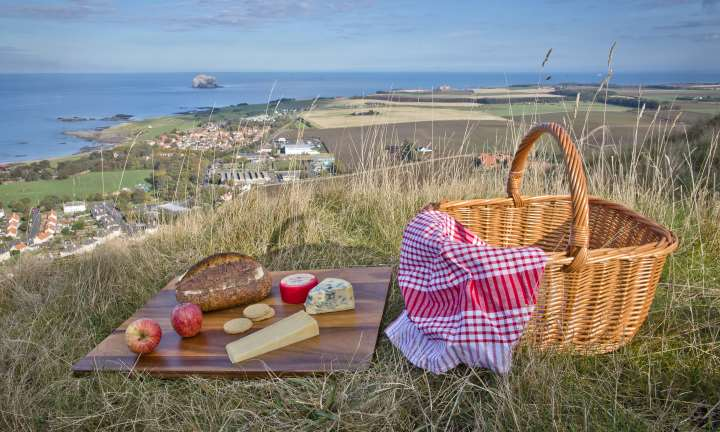 Picnic of Scottish cheeses and Local East Lothian bread on The North Berwick Law overlooking the Bass Rock.