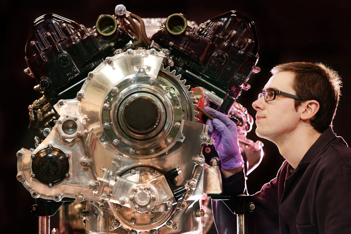 Assistant Conservator Simon Stephens cleans a 1942 Rolls-Royce Merlin 73 aircraft engine.