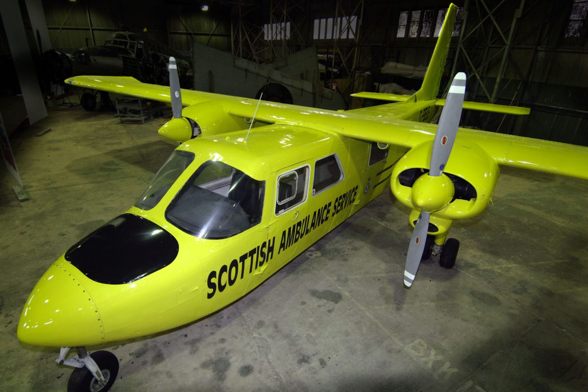 A Britten Norman Islander painted yellow with text that reads 'Scottish Ambulance Service' © National Museums Scotland.
