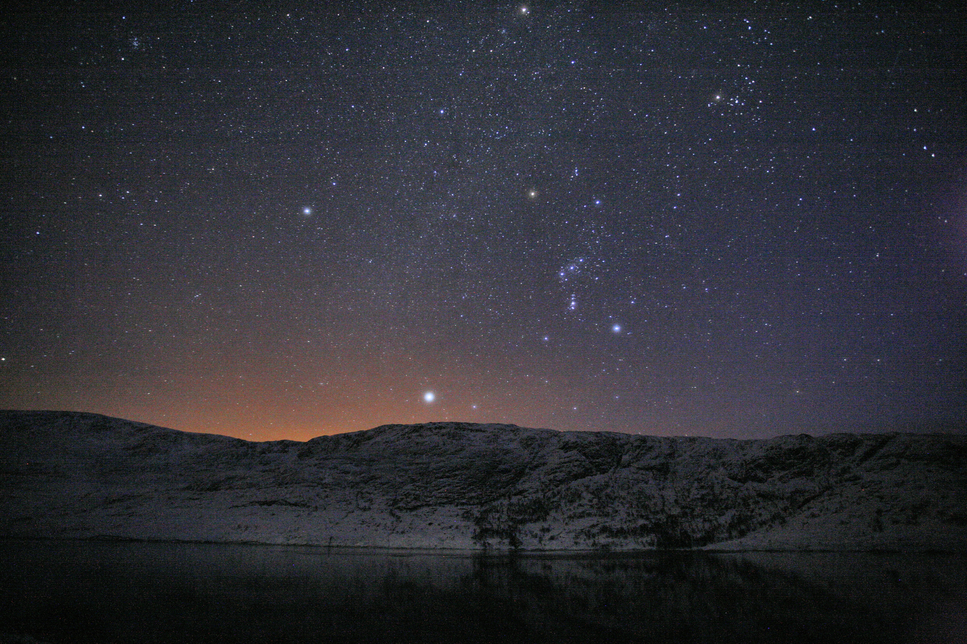 A clear, starlit winter night across Loch Cluanie