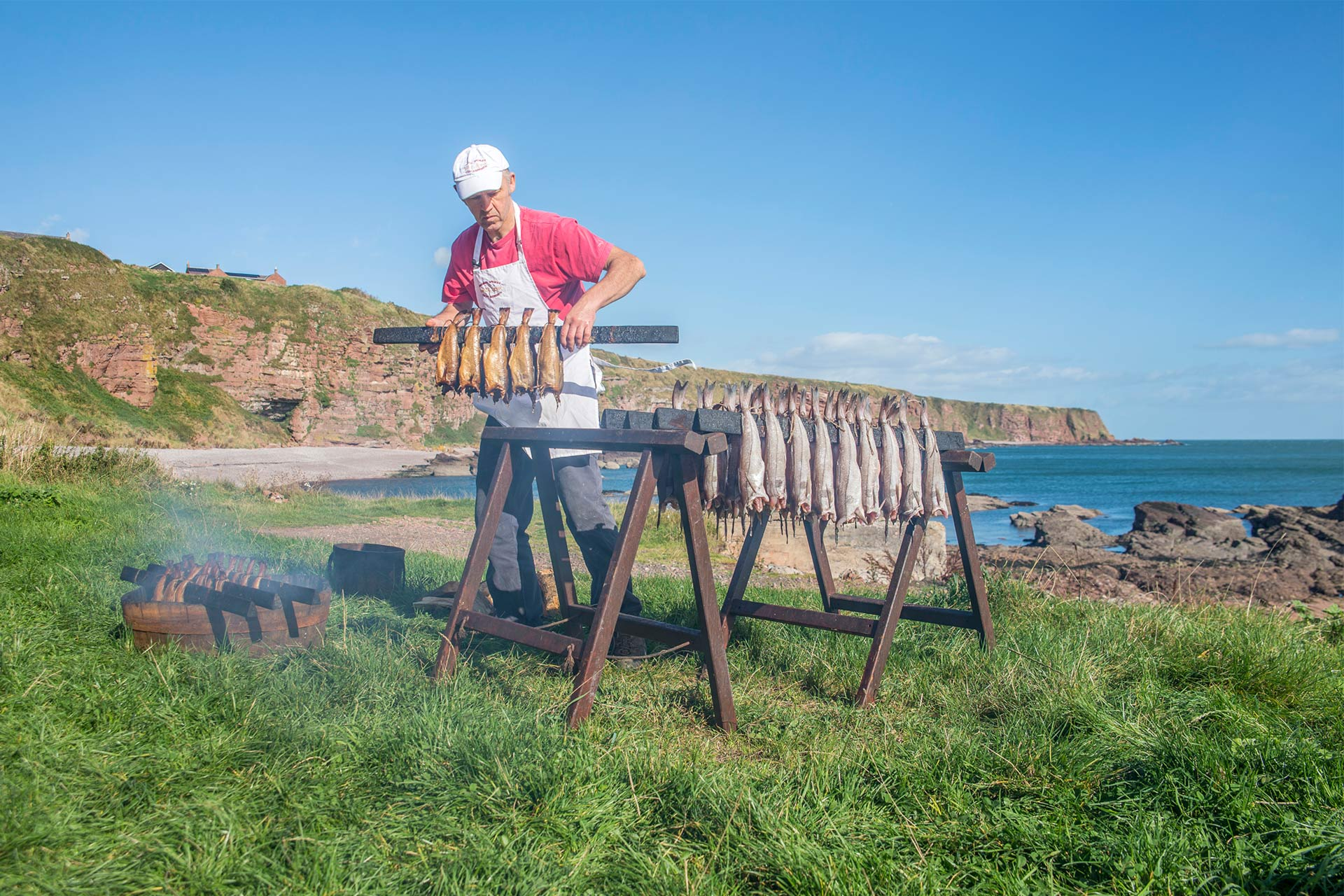 Arbroath smokies being prepared by Iain R Spink on the beach at Auchmithie © VisitScotland / Kenny Lam