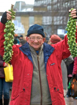 A man holding Brussels sprouts