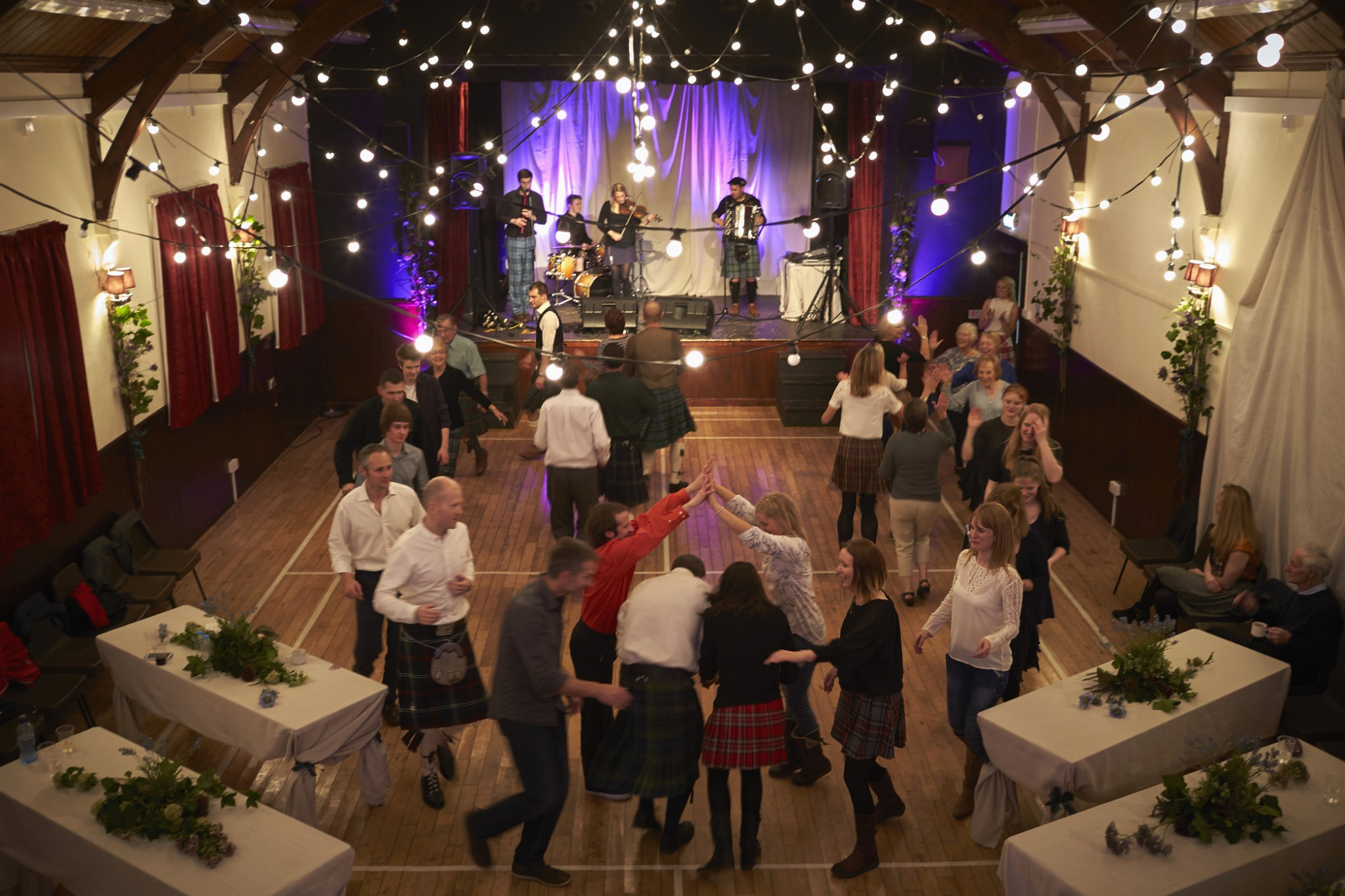 People participate in a traditional Scottish Ceilidh, Fintry Town Hall.
