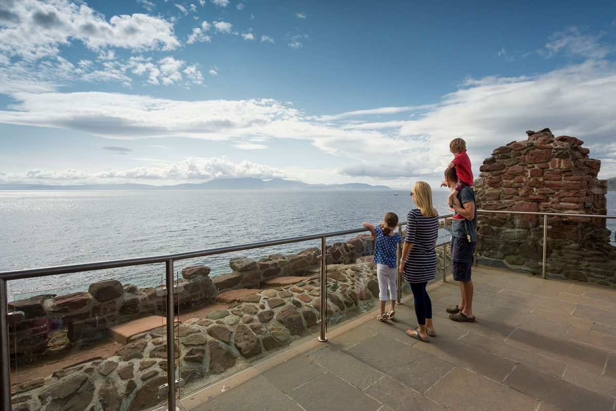 A family visit Portencross Castle, taking in the view over the Firth of Clyde towards the Isle of Arran, near West Kilbride, North Ayrshire Picture Credit : Paul Tomkins / VisitScotland