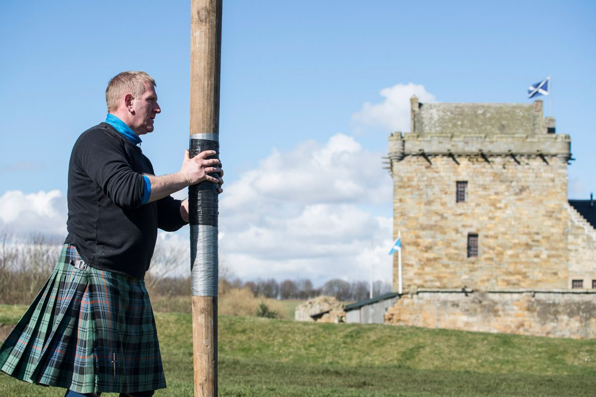 Jamie Barr demonstrating the Caber Toss at Balgonie Castle.