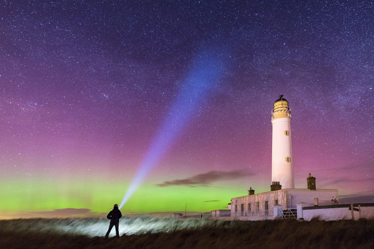 Aurora Borealis lights up the night sky with a spectrum of colour and serves as a perfect backdrop for Barns Ness Lighthouse © Sarah White