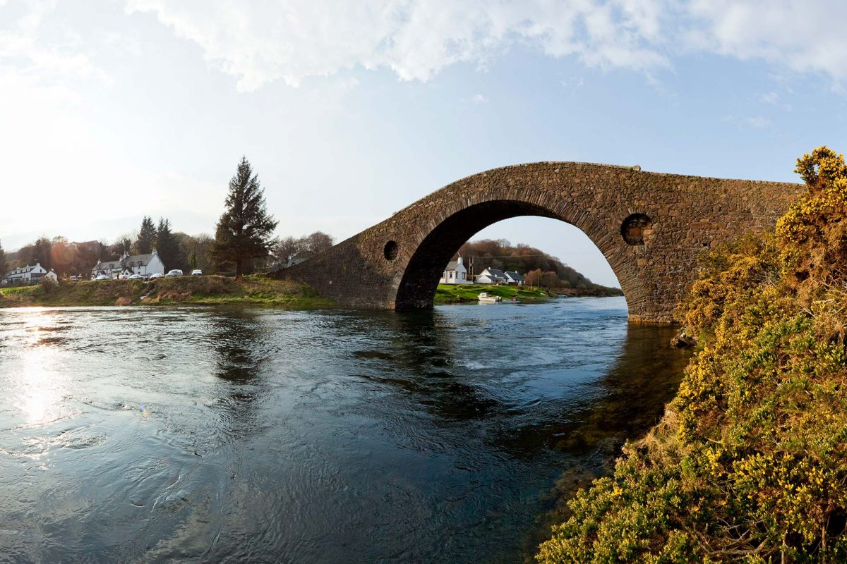 The Clachan Bridge known as Bridge Over The Atlantic crossing the Clachan Sound to the Isle of Seil (beyond), Argyll Picture Credit : Paul Tomkins / VisitScotland