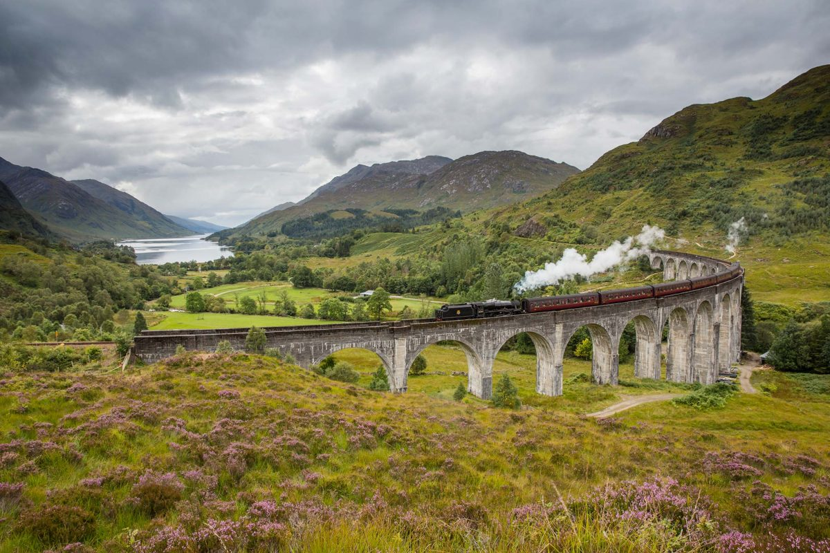 The Jacobite steam train passing over the Glenfinnan Viaduct at the head of Loch Shiel, Lochaber, Highlands of Scotland