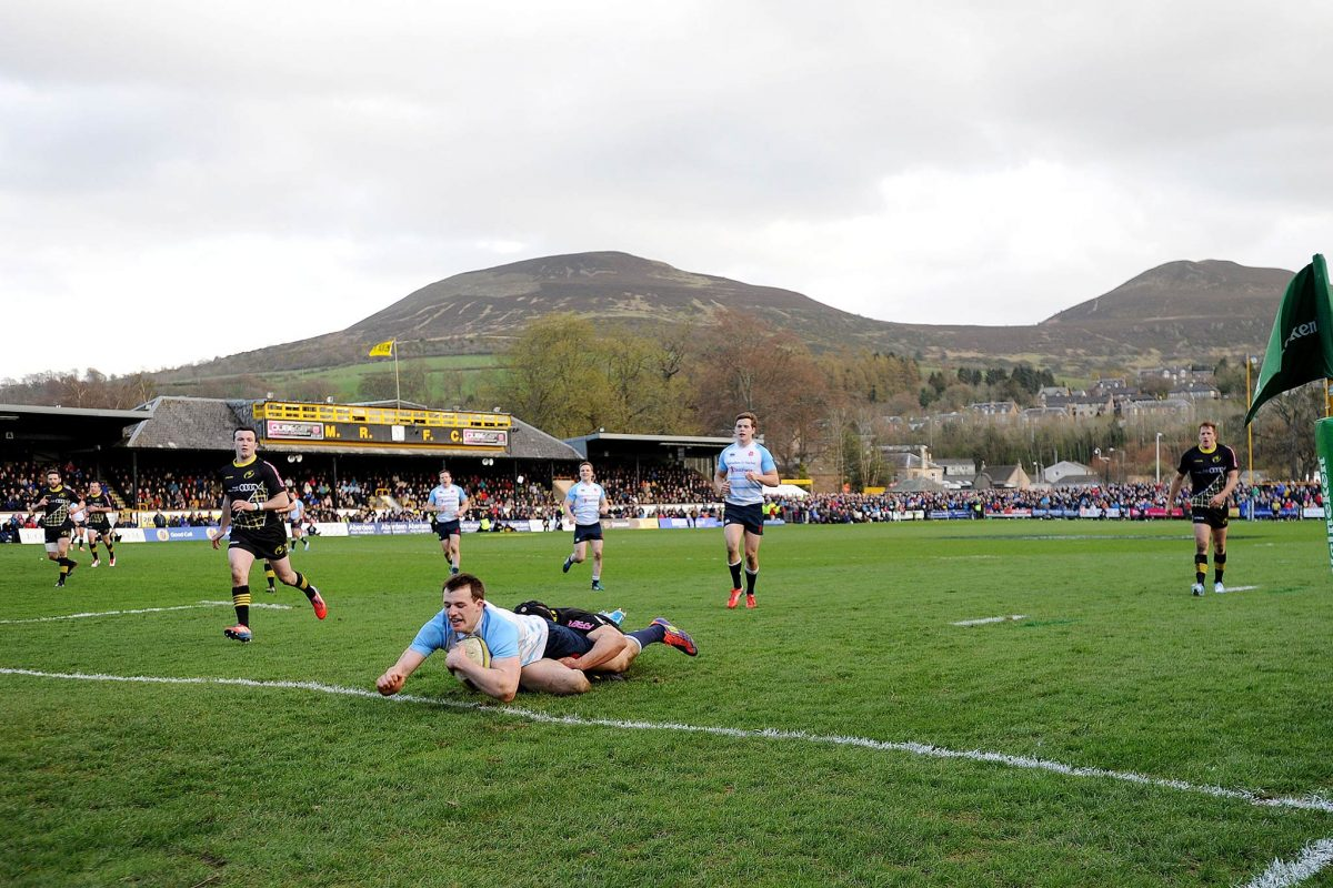 The Melrose Sevens View of the Greenyards with the Eildon Hills in distance. Melrose v Edinburgh Accies tie, Nyle Godsmark scores a try.