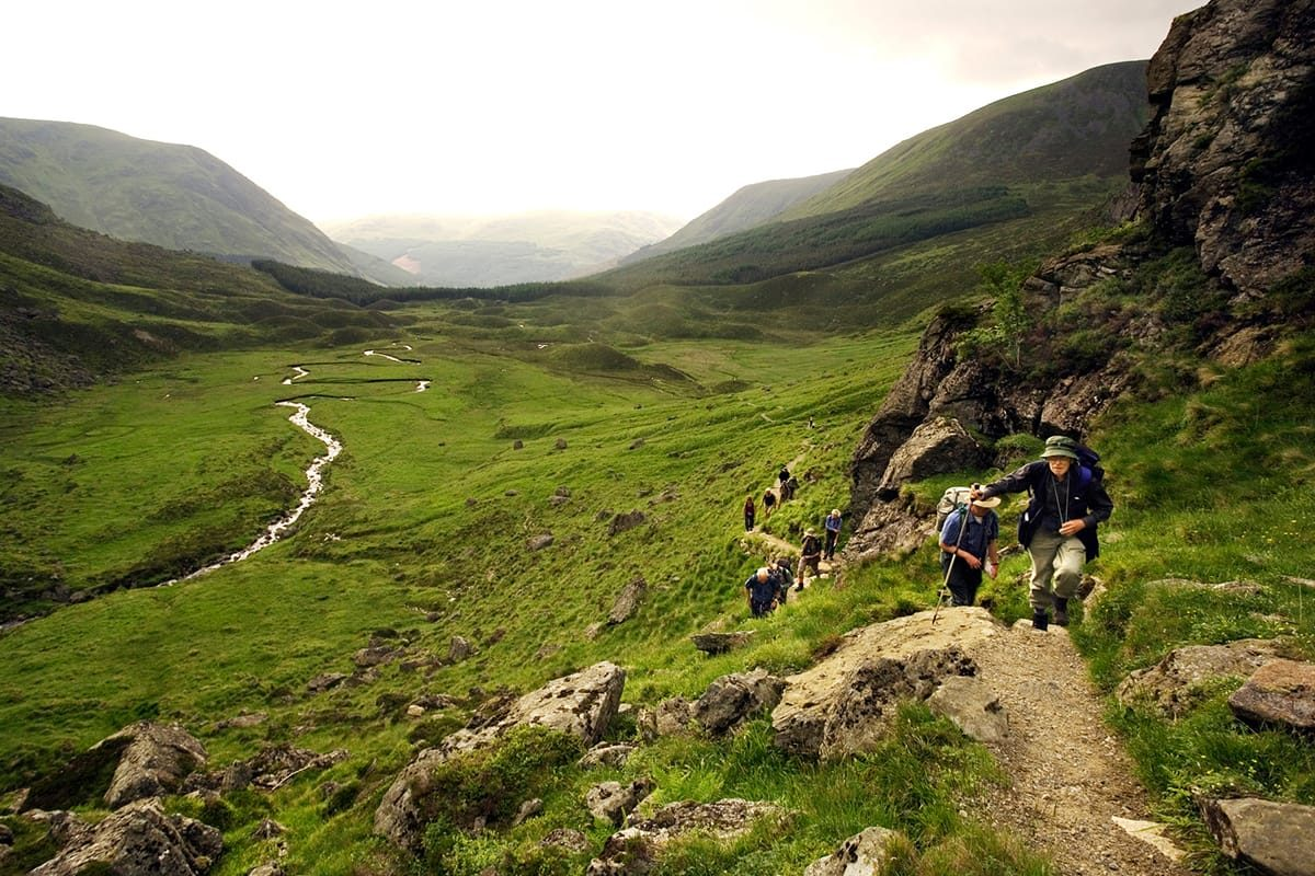 A group of walkers on a nature walk into Corrie Fee, Angus