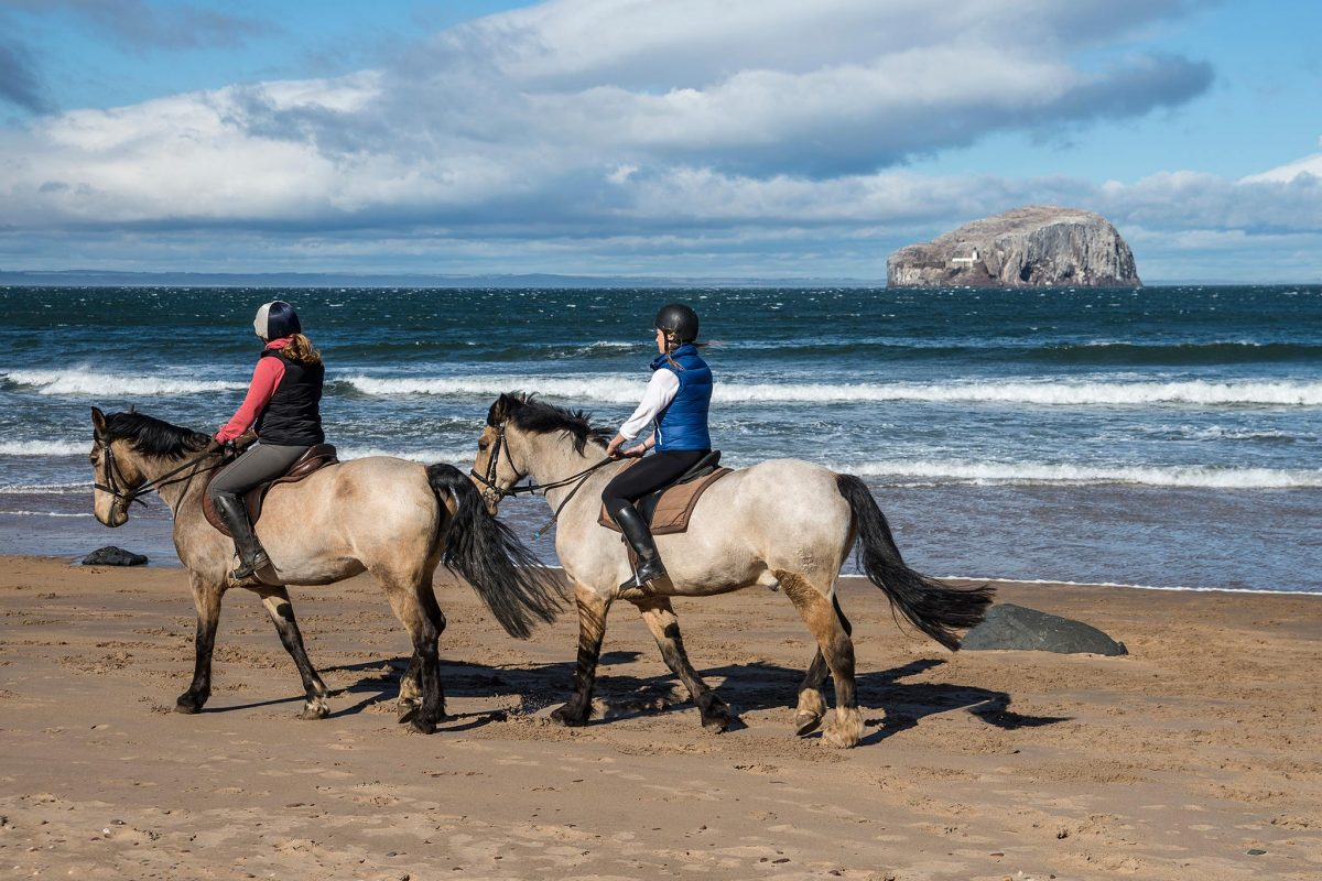 Horse riding at Seacliff Beach, East Lothian