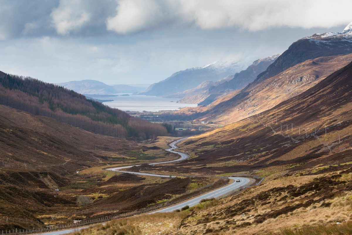 The road to Kinlochewe on the North Coast 500 with Loch Maree beyond