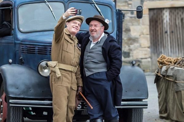 Eddie Izzard and Gregor Fisher on the set of Whisky Galore!