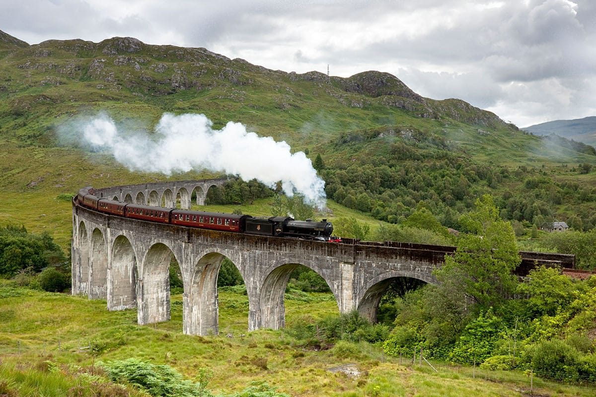 The Jacobite steam train passing over the Glenfinnan Viaduct at the head of Loch Shiel, Lochaber, Highlands