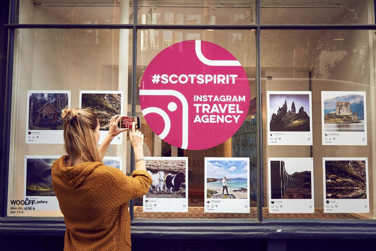 Looking at the window of the #Scotspirit Instagram Travel Agency, London © VisitScotland/Mikael Buck