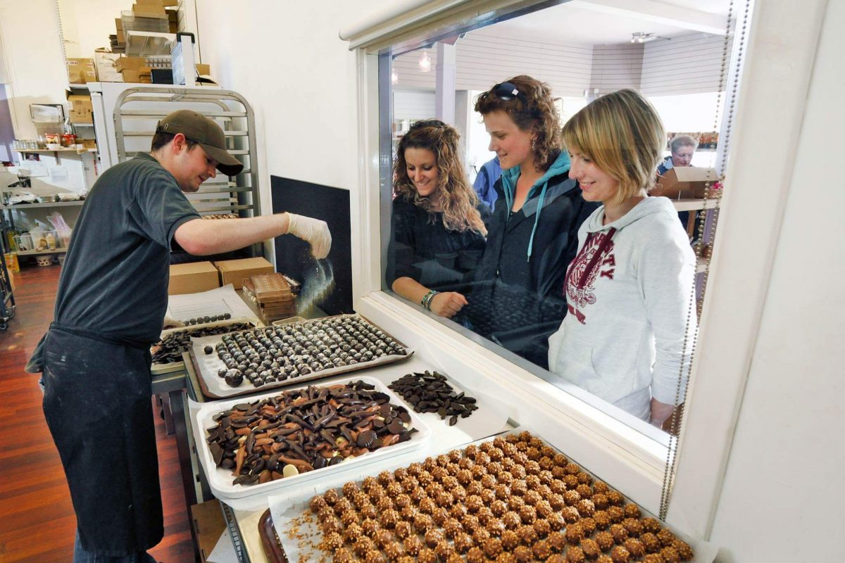 Delighted customers at Oban Chocolate Company watch production