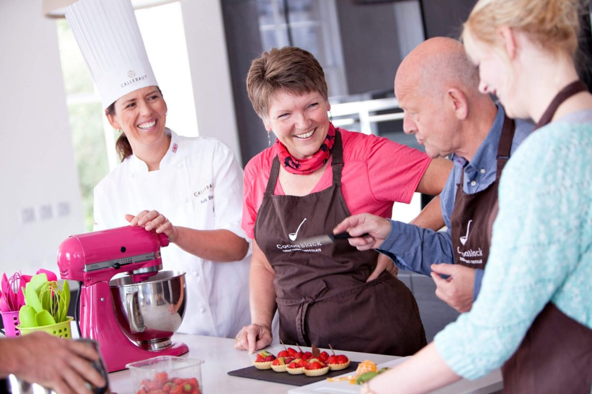 Three clients enjoy a masterclass with Chocolate Master Ruth Hinks at Cocoa Black