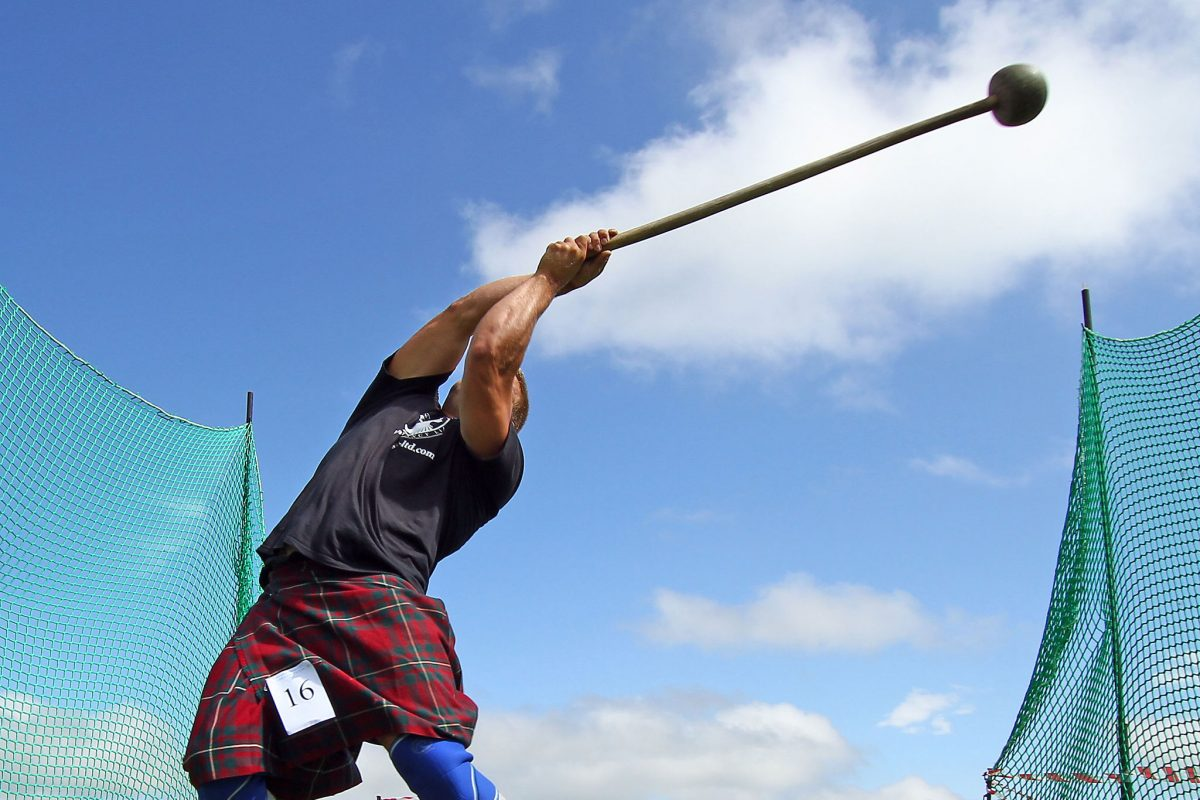 Action shot of hammer thrower competing at Halkirk Highland Games.