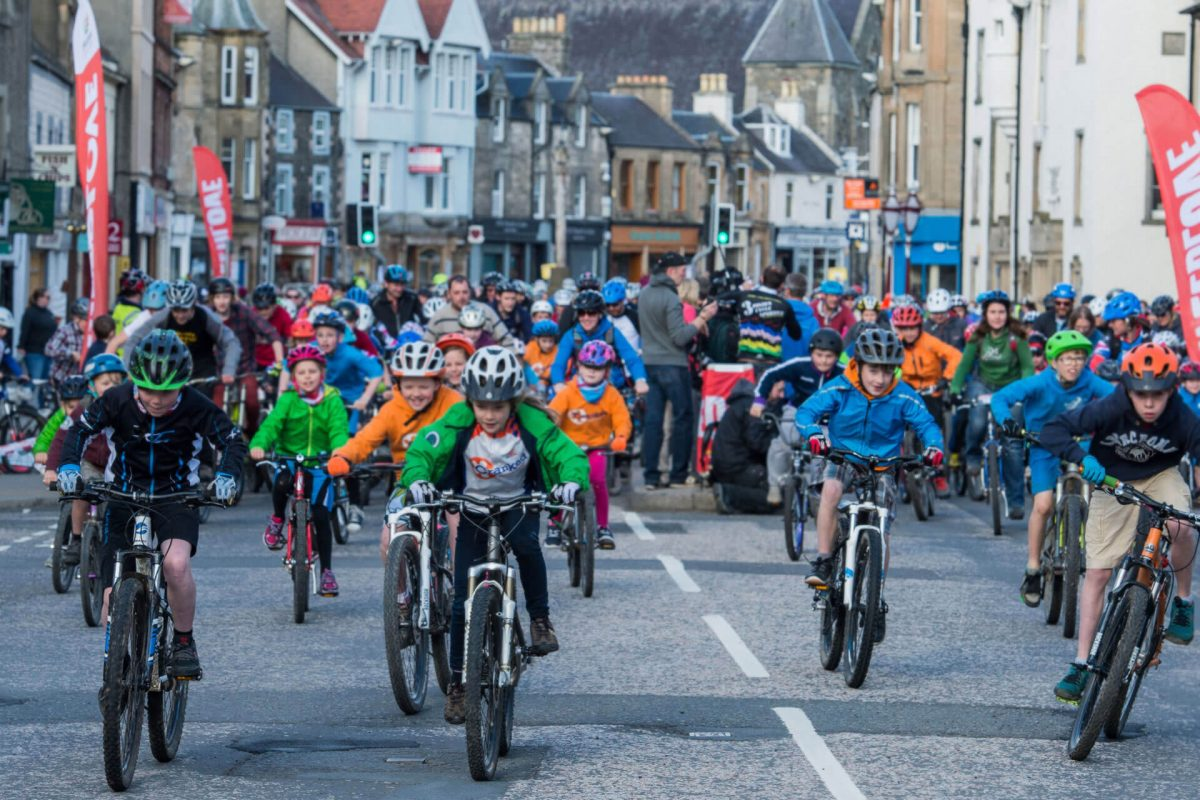 A TweedLove Family Fun Ride heads through Peebles, Scottish Borders