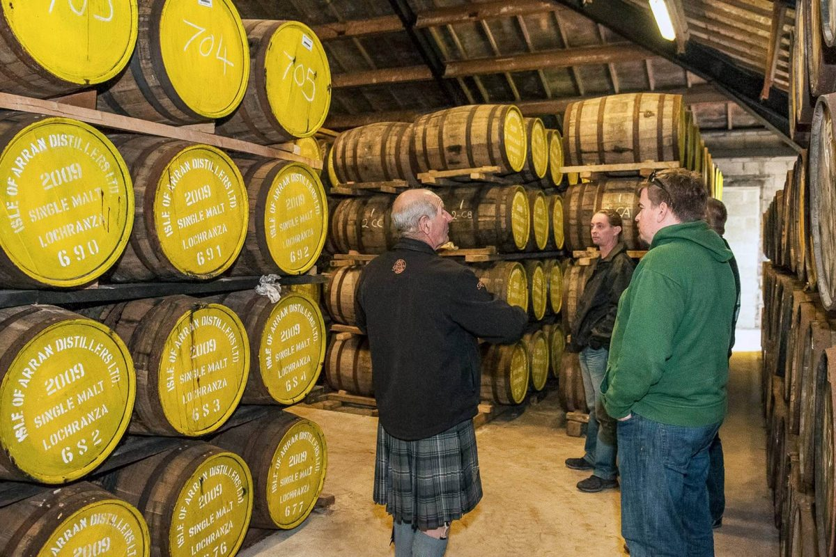 Tour group in the cask store, Isle of Arran Distillery © Ayrshire & Arran Tourism, all rights reserved.