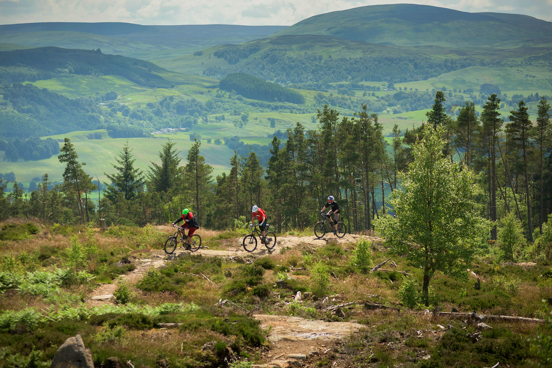 Two people mountain biking in the Perthshire Hills