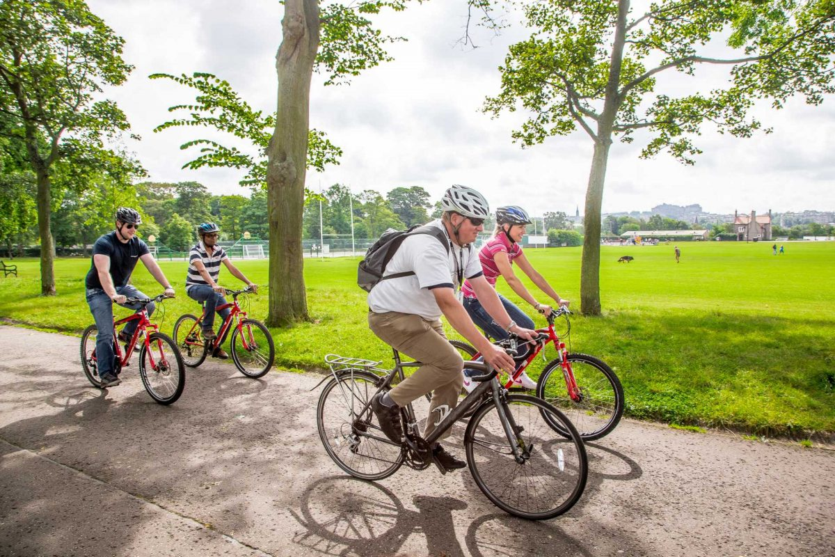 Cycling through Inverleith Park, Edinburgh