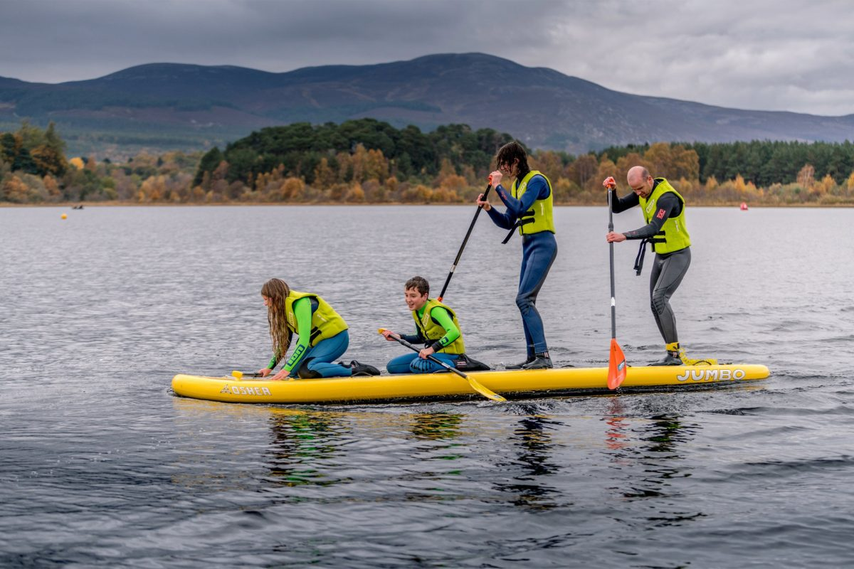 Family-fun paddleboarding at Loch Insh Watersports near Aviemore