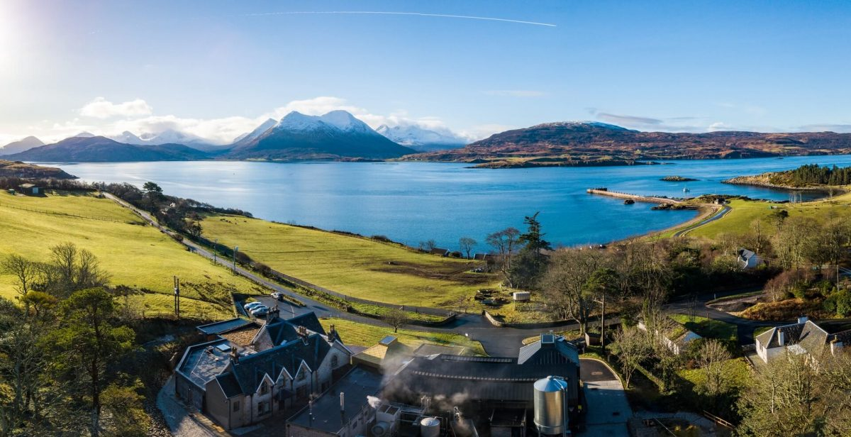 Isle of Raasay Distillery with the Skye Cuillin beyond