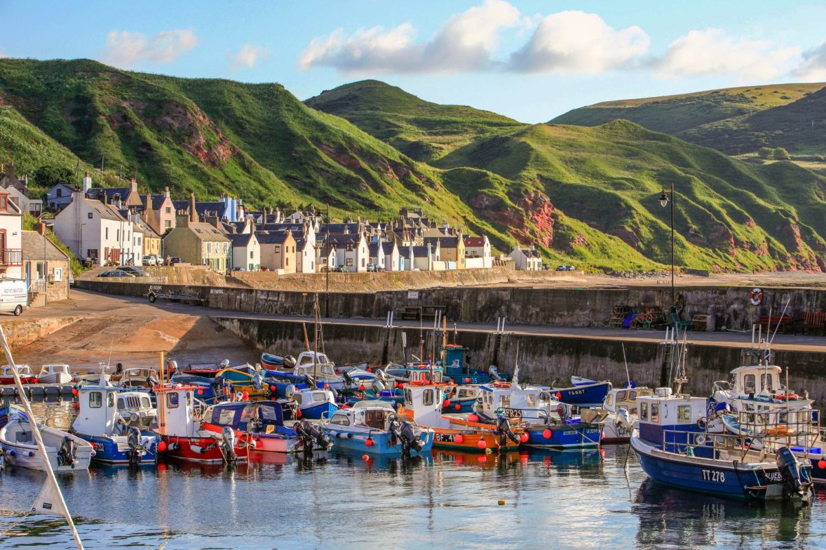 Fishing boats moored in Gardenstown Harbour, Banffshire