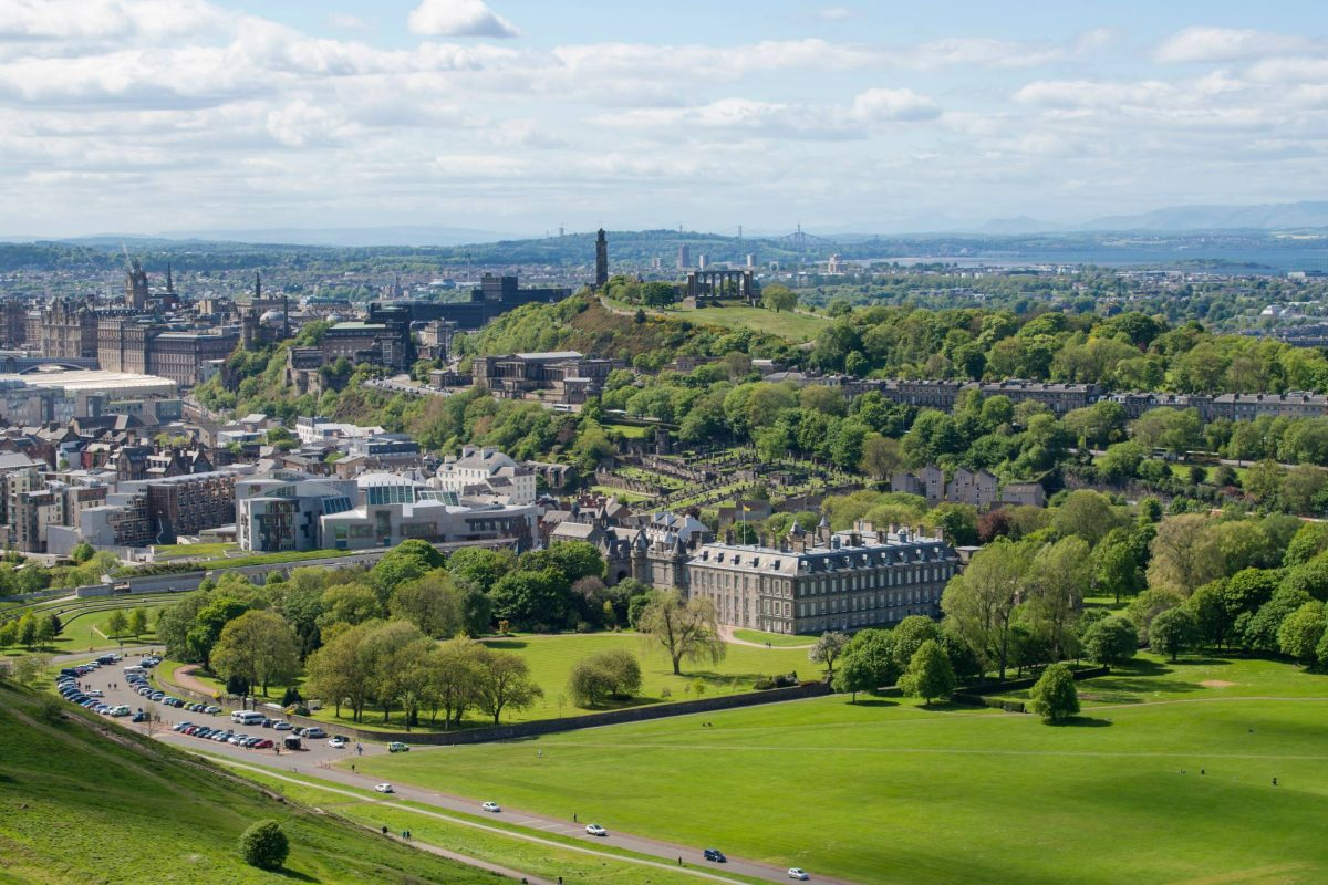 The Palace of Holyroodhouse and Holyrood Park with Edinburgh beyond
