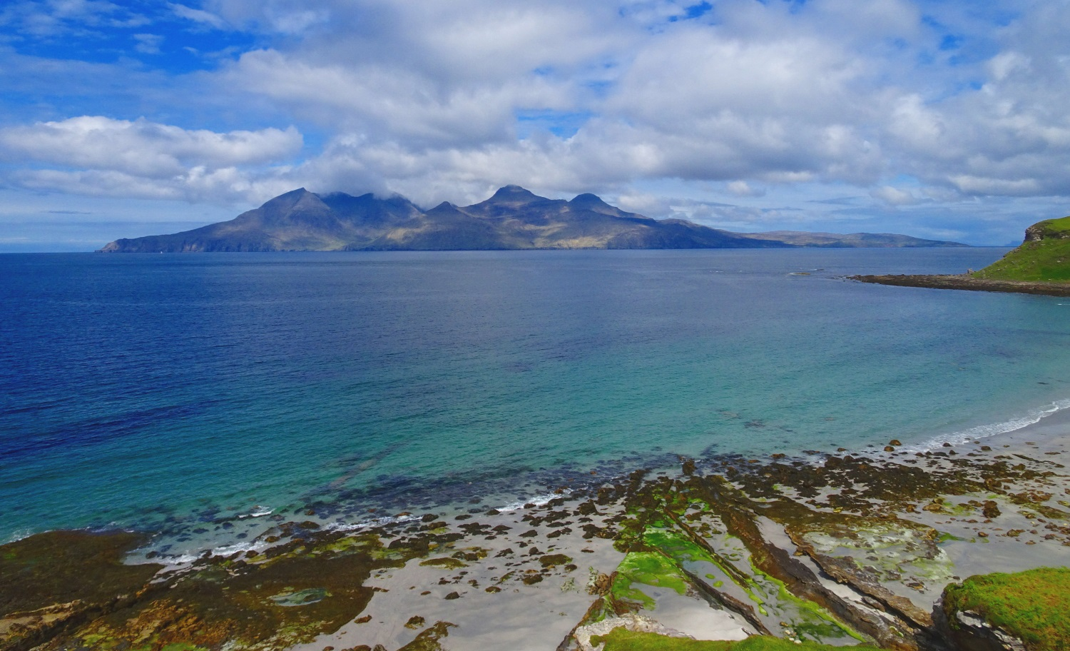 Bay of Laig on the Isle of Eigg with views towards the Isle of Rum