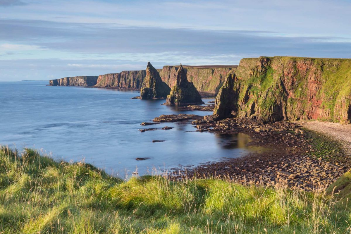 The rock formations of the Duncansby Stacks by the cliffs and sea, near John O'Groats