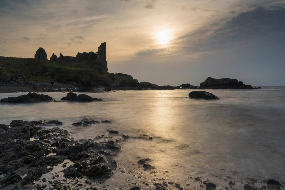 Dunure Castle sitting on the cliffs over the beach in south Ayrshire