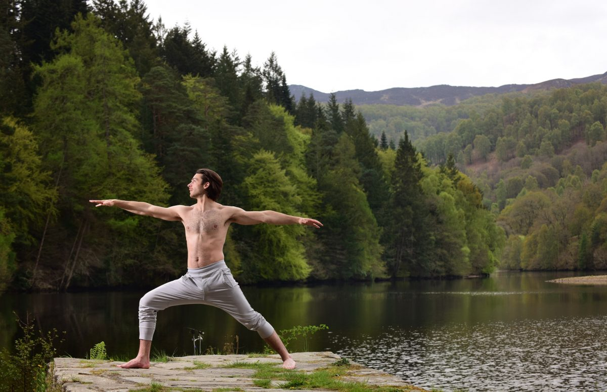 A man practicing Yoga and Wellness at Loch Faskally