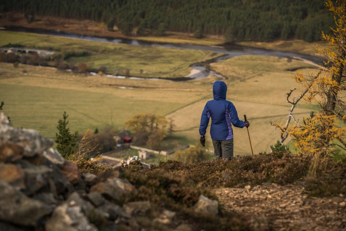 Two hillwalkers and their dogs enjoy the Braemar countryside, The Cairngorms National Park.