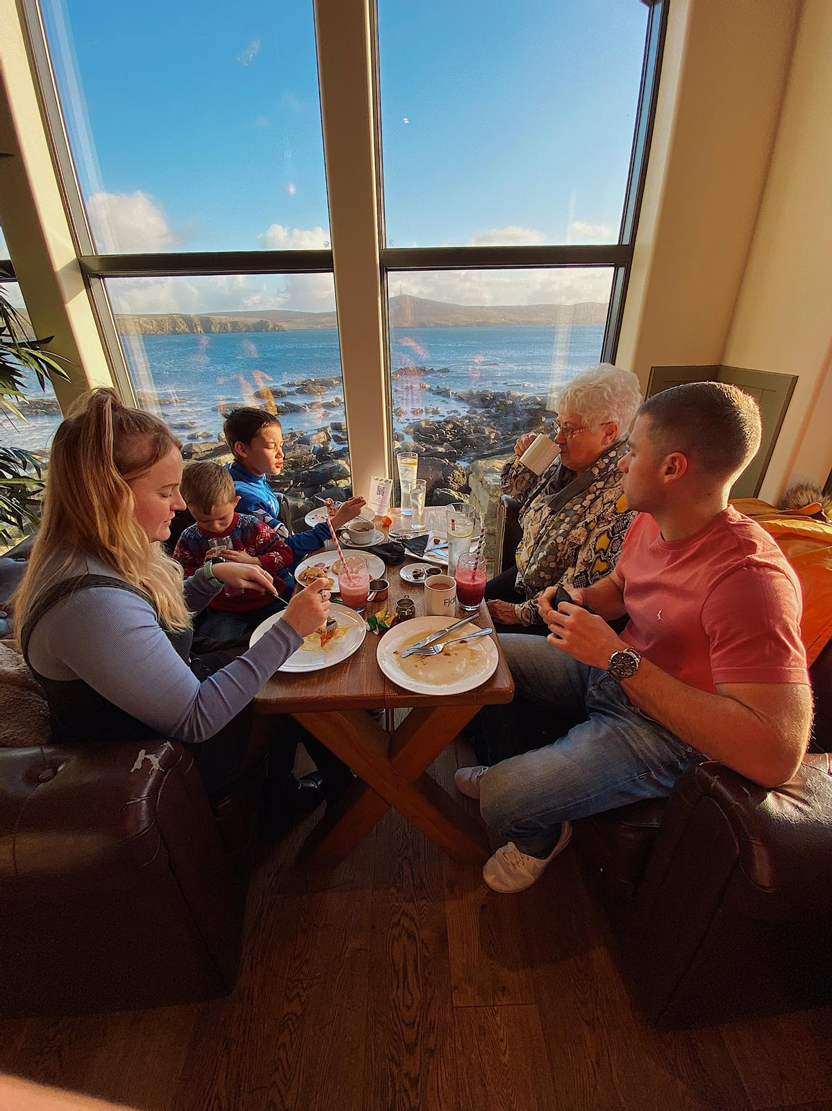 Family eating breakfast in Fjara Cafe, Lerwick © Ashlea Simmons