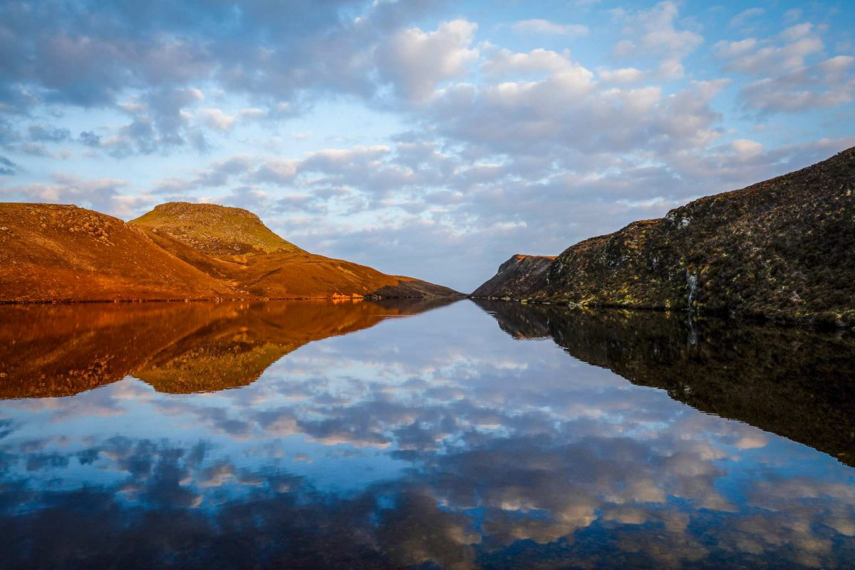 The sky reflects off the loch water, under Dun Caan, Raasay