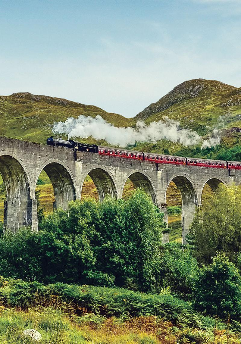 Jacobite Steam Train passing over the Glenfinnan Viaduct at Loch Shiel, Highlands