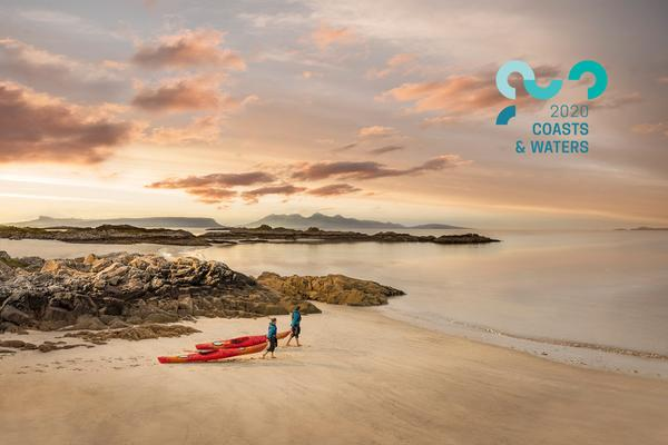 Kayakers on Camusdarach Beach near Arisaig, Highlands