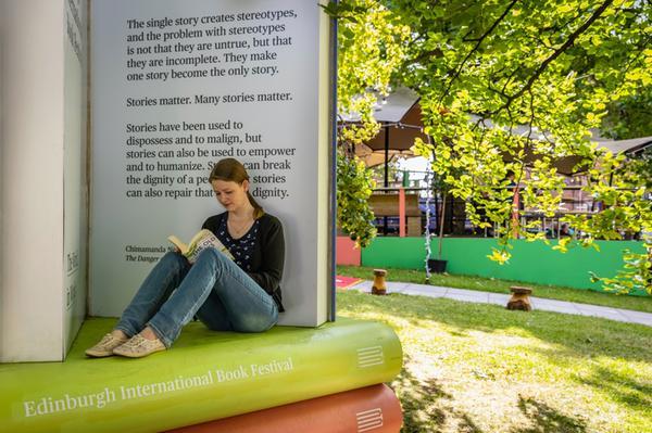 Reading a book at Edinburgh Book Festival