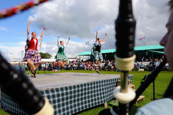 Dancers taking part in the Aboyne Highland Games to the sounds of bagpipes
