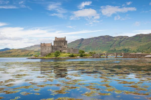 Eilean Donan Castle and Loch Duich surrounding it, near Dornie, on a sunny day