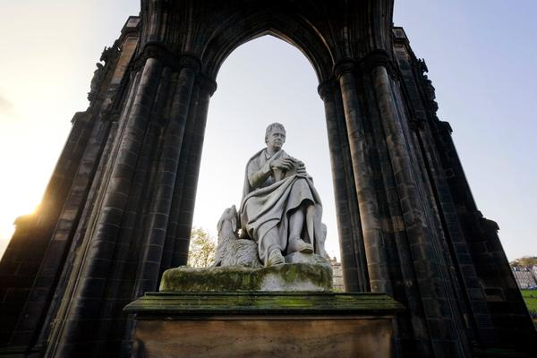 The statue of the writer Sir Walter Scott (by Steell) below The Scott Monument in Princes Street Gardens East, Edinburgh